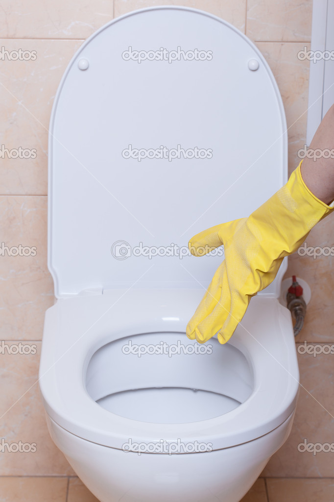WC hygiene concept, hand in yellow glove making signs  Stock Photo #11976048