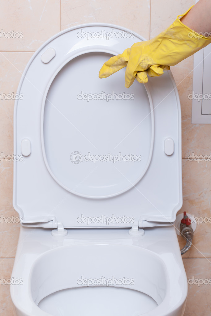 WC hygiene concept, hand in yellow glove making signs — Stock Photo #11976055