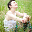 Girl resting on fresh spring grass - Stock Photo