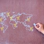 World map with trolley on school blackboard. — Stock Photo #11198800