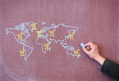 World map with trolley on school blackboard. — Stock Photo