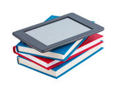 Books with e-reader. — Stock Photo