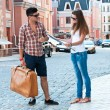 Guy with suitcase and girl with map. — Stock Photo #11653871