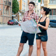 Young couple looking at map. — Stock Photo