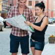 Young couple looking at map. — Stock Photo #11653973