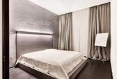 Modern minimalism style bedroom interior in monochrome tones — Stock Photo