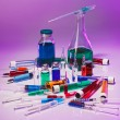 Medical laboratory glass equipment still life on blue purple — Foto Stock