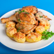 Roast chicken with potatoes and greens — Stock Photo