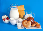 Still life with dairy products and rolls — Stock Photo