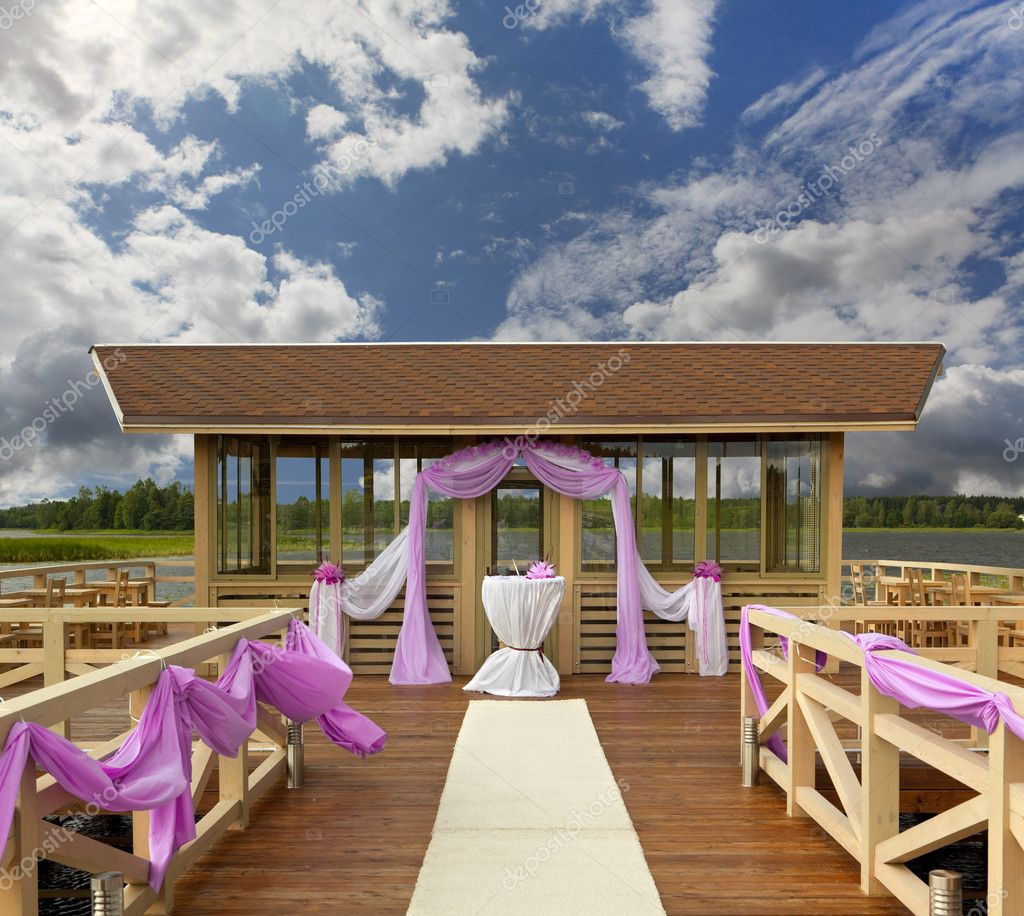 Place for wedding on a pier at the lake — Stock Photo #12382296