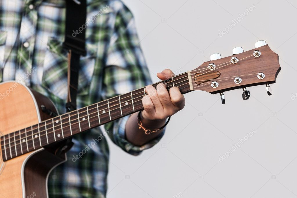 Musician or guitarist playing guitar string music instrument — Stock Photo #11236057