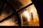 Lamp light in church window — Stock Photo
