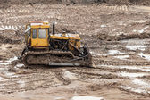 Bulldozer at building construction site — Stock Photo