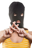 Woman in balaclava showing jail or prison finger gesture — Stock Photo