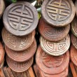 Decorated Traditional Chinese Roof Tiles - Stock Photo
