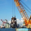 Stock Photo: Dredger lifts Mud from Harbor Berth