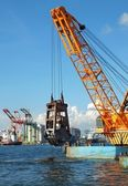 Dredger lifts Mud from Harbor Berth — Stock Photo