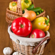 Fresh vegetables and tomatoes in baskets — Stock Photo