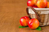 Juicy nectarines in the basket — Stock Photo