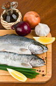Close-up raw fish trout on a wooden board — Stock Photo