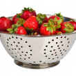 Fresh strawberries in colander — Stock Photo
