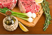 Raw meat with rosemary closeup — Stock Photo