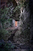 Door into the dark mountain — Stock Photo