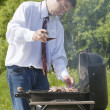 Man coocing meat. — Stock Photo