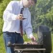 Man coocing meat. — Stock Photo