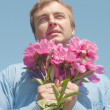 Man and flowers. — Stock Photo