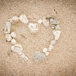 Shells on the ocean beach, heart shape background — Stockfoto