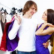 Stock Photo: Young couple doing shopping together