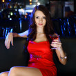 Attractive woman in night club with a drink — Stock Photo