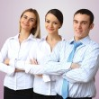 Three successful young business persons together — Stock Photo #10828859