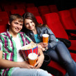 Royalty-Free Stock Photo: Young couple in cinema watching movie