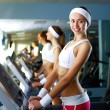 Young woman doing sport in gym — Stock Photo #10829252