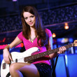 Young guitar player performing in night club — Stock Photo #10829659