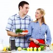 Husband and wife together coooking at home — Stock Photo #10829677