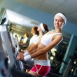 Young woman doing sport in gym — Stock Photo #10829812