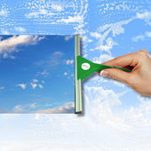 Window with blue sky and white clouds — Stock Photo