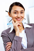 Young woman in business wear working in office — Stock Photo