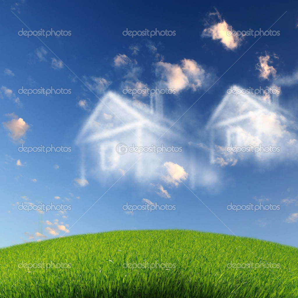 Picture of a house from white clouds against blue sky — Stock Photo #10827831