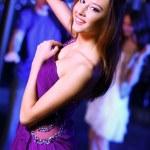 Young woman having fun at nightclub disco — Stock Photo #10830070