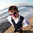 Young businessman against sea background — Stock Photo