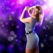 Young woman and disco background - Stock Photo