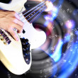 Young guitar player performing in night club — Stockfoto