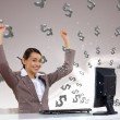 Businesswoman at workplace and money symbols — Stock Photo