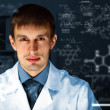 Young chemist working in laboratory — Stock Photo #10831728