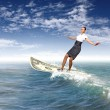 Stock Photo: Businesswomsurfing on sewaves