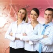 Three successful young business persons together — Stock Photo #10832089